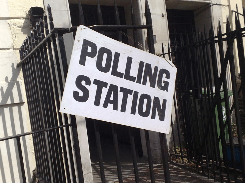 Polling station poster on railings